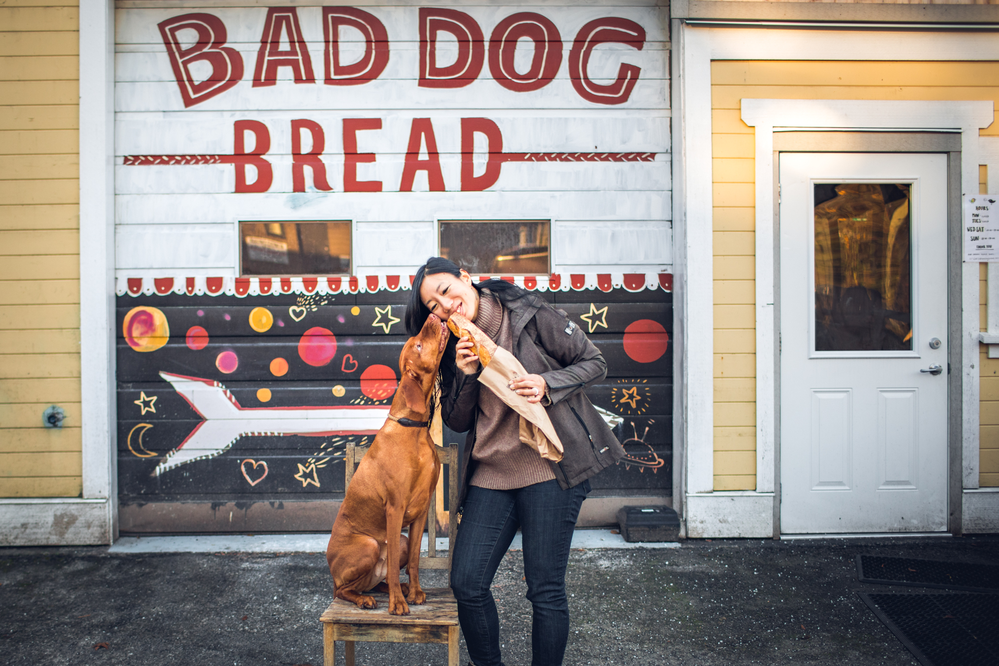 Woman and Dog eating baguette