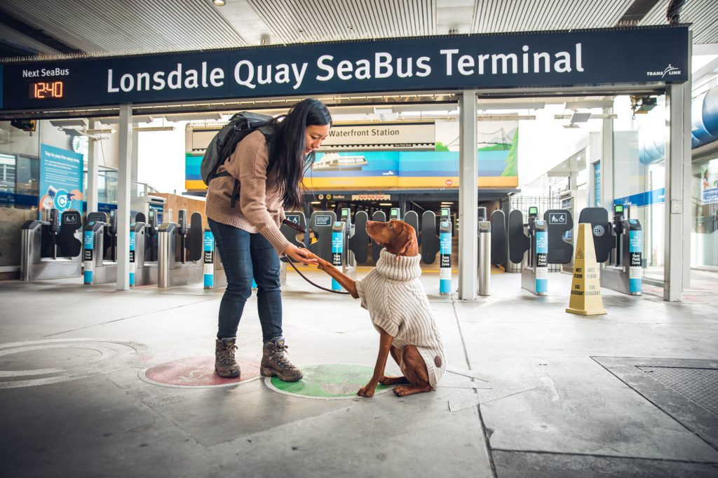 Woman and dog at dog-friendly seabus station