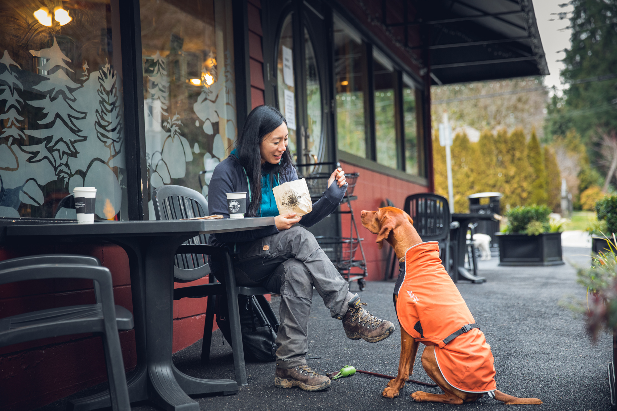 Woman and dog at cafe