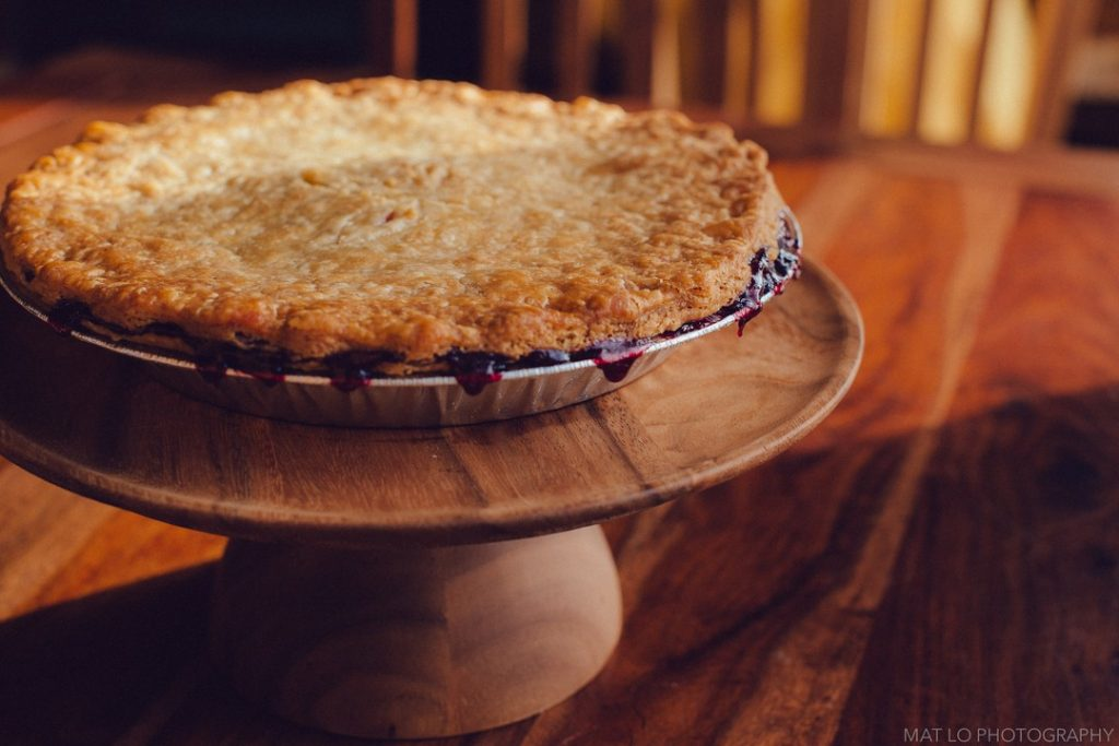pie on a wooden pie stand