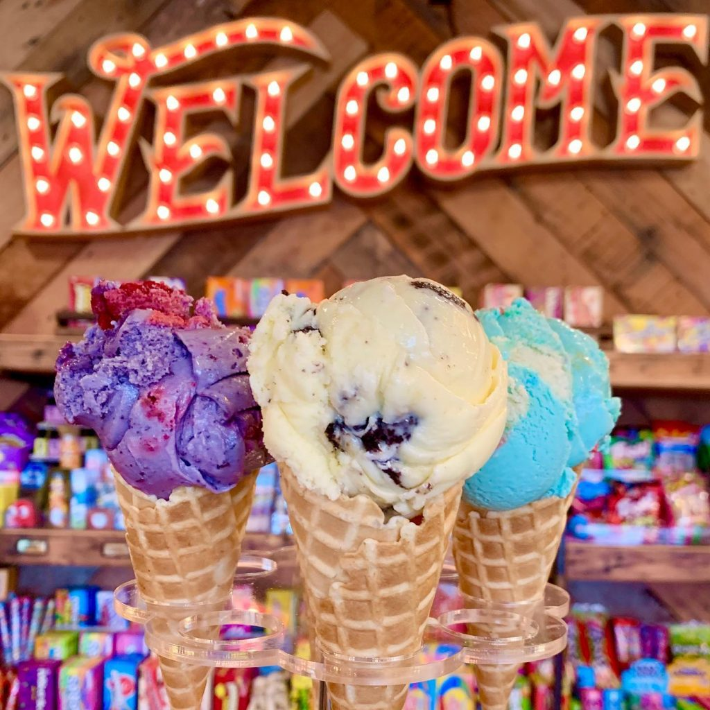 bright colour ice creams in front of neon sign