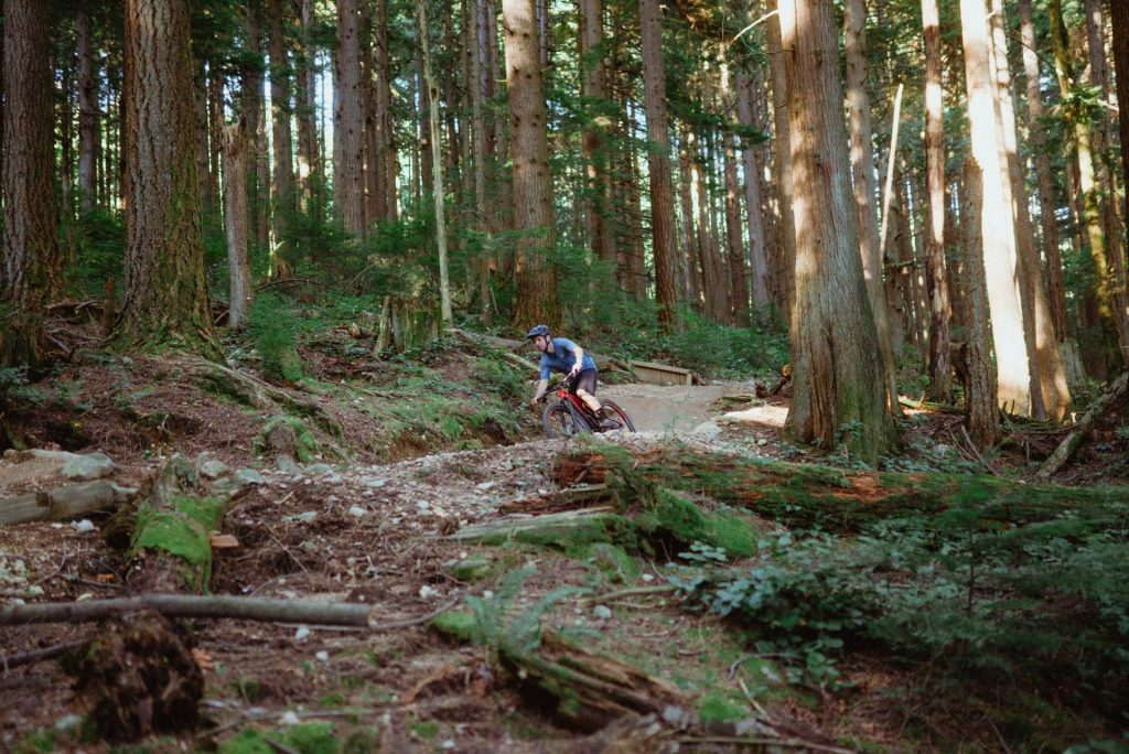 man mountain biking on vancouvers north shore