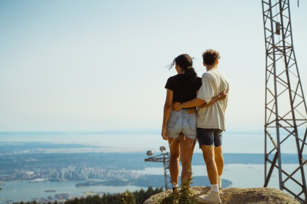 Couple standing on top of Grouse Mountain