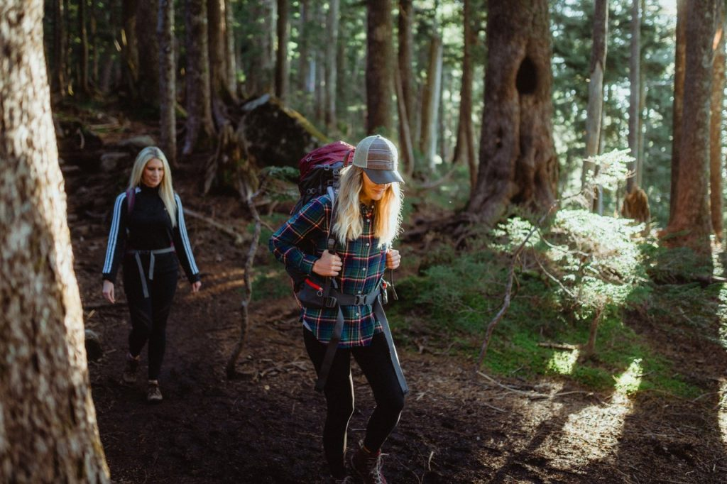 Two women hiking in forest